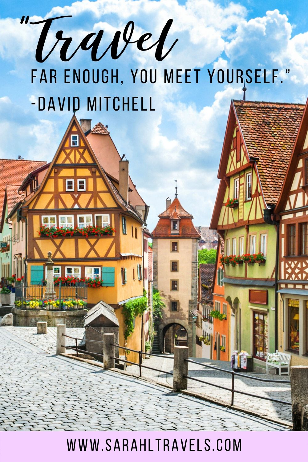 """Quaint buildings in a German town with quote """"Travel far enough, you meet yourself."""""""