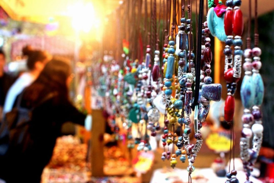 Row of necklaces at an art market
