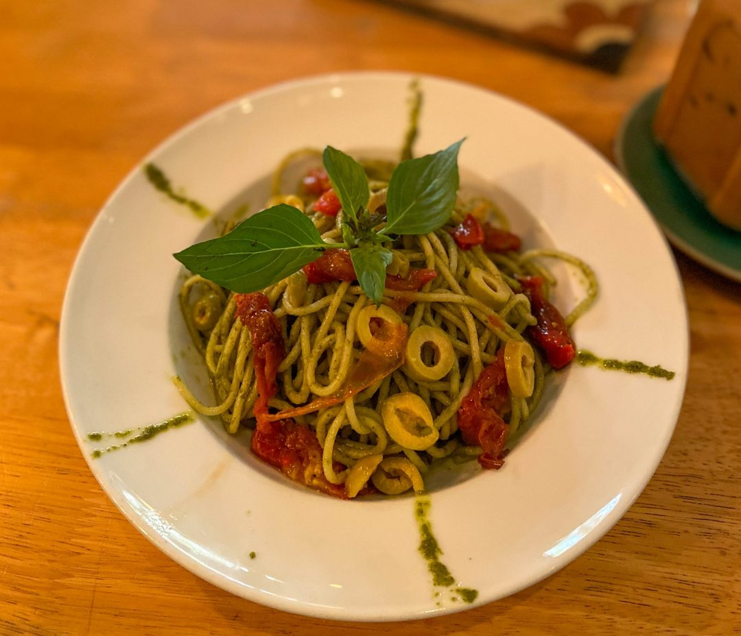 vegan pesto pasta with green olives from Footprint Café