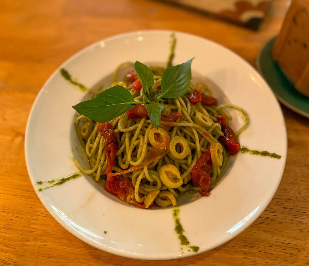 vegan pesto pasta with green olives from Footprint Café