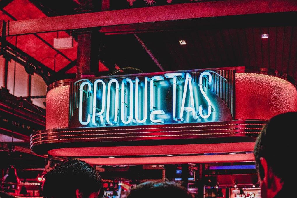 "neon sign saying ""croquetas"""