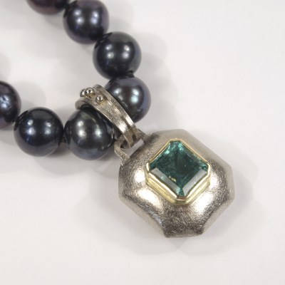 Heather's Bespoke Emerald & Gold Pendant On Black Pearls