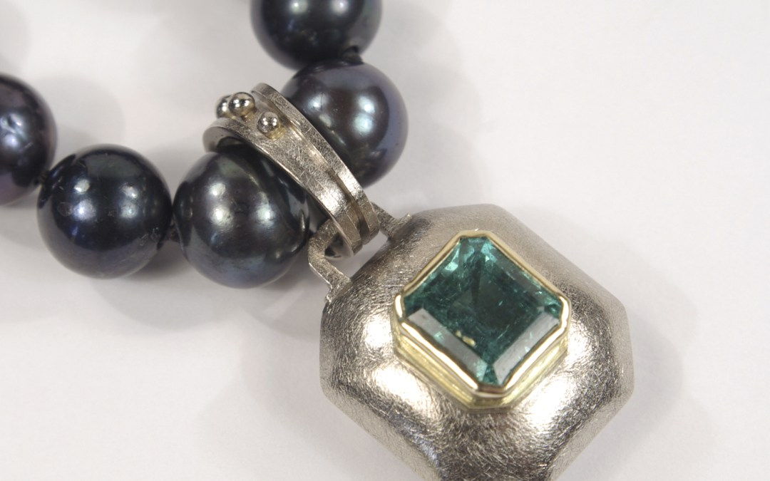 Heather's Bespoke Emerald And Gold Pendant On Black Pearls