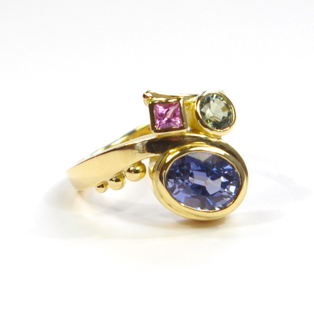 Nuala's Gold Curl Ring With Multi-Coloured Sapphires