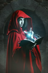 Red hooded woman casting powerful magic