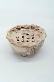 circular soap pillow in white and blue slipware with pie crust rim and drainage holes