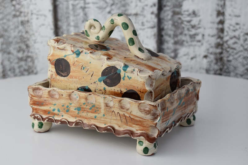 brown dotty butterdish with green polka dot handleby sarah monk ceramics
