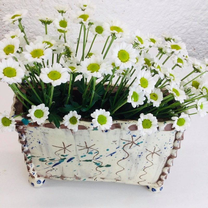 Rectangular slab vase with sgraffito flowers by Sarah Monk in cream with fresh white flowers displayed (aerial view)
