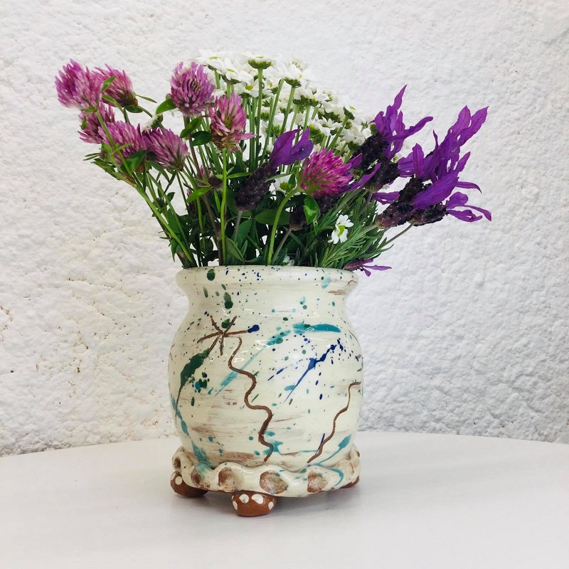 Thrown vase with four little feet by Sarah Monk in cream with sgraffito daisies