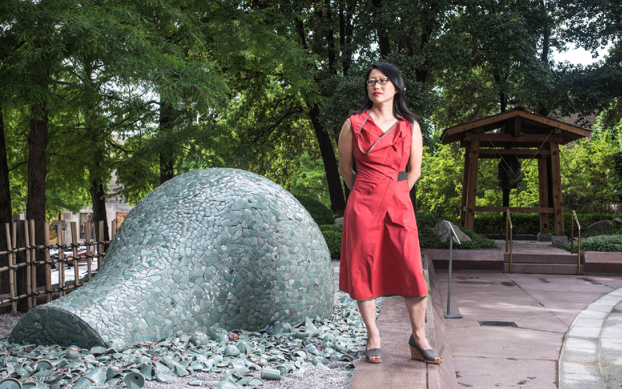 "Artist Jean Shin poses with her installation ""Celadon Landscape"""