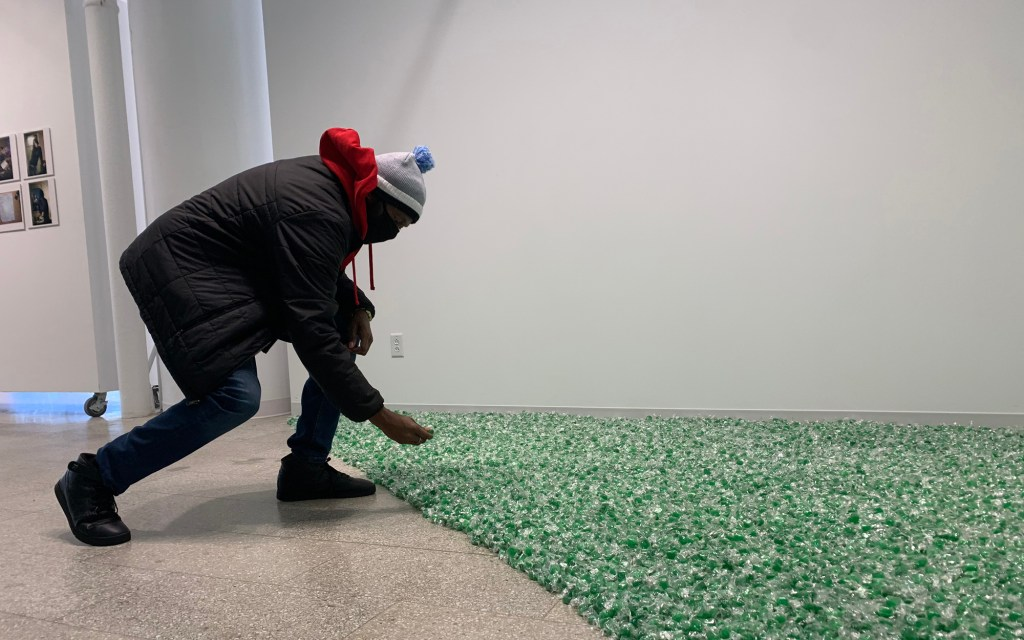 """Felix Gonzalez-Torres, """"Untitled"""" (L.A.), 1991 Green candies individually wrapped in cellophane, endless supply Overall dimensions vary with installation Original weight: 22.7 kg (50 lbs) Jointly owned by Art Bridges and Crystal Bridges Museum of American Art © The Felix Gonzalez-Torres Foundation"""