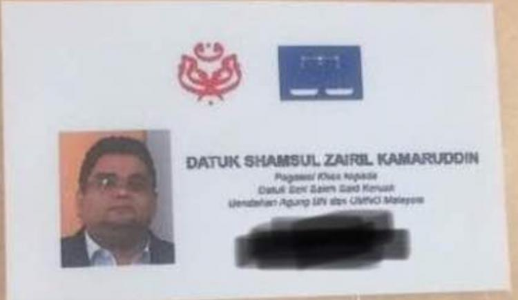 UMNO logo and the name of his boss Salleh Keruak are emblazoned on Shamsul's business card