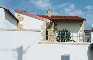 rivestimento facciate case in finta pietra provincia di Oristano