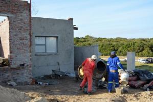 Builders working with cement at Sardinia Bay Estate.