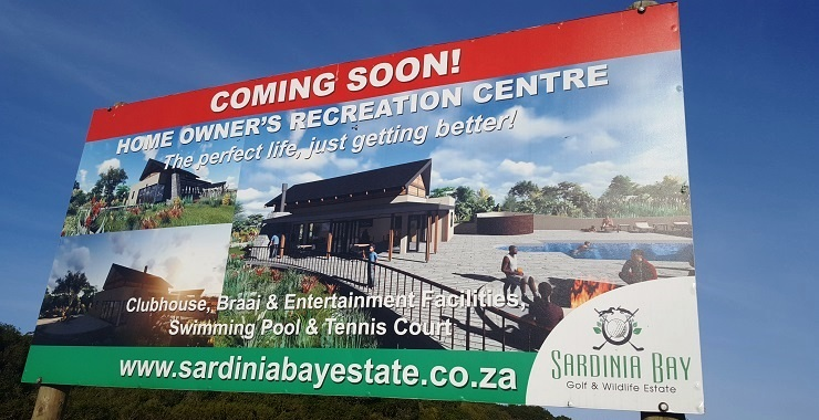 A notice board marks where the new residents' recreation centre – featuring a braai area, swimming pool, tennis court and meeting room – will be built.