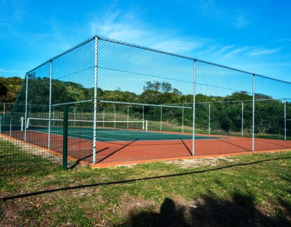 The tennis court is one of the incentives which drew Port Elizabeth businessman Gavin Hogg and his wife to the Sardinia Bay Golf & Wildlife Estate