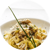 a dish of tagliatelle with fresh mushrooms