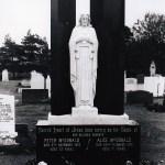 white marble Sacred Heart against black granite