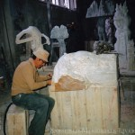 man hand carving from solid marble rock a sculptured tomb
