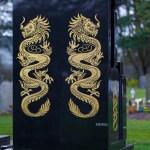 gold dragon on black marble