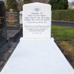 White Jewish headstone with marble slab