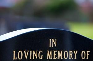 guilded lettering on gravestone