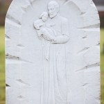 carved white st christopher head stone