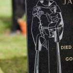 St Christopher ornamental etching on gravestone