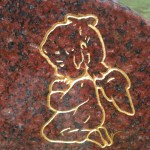 gold kneeling child angel headstone gold engraving