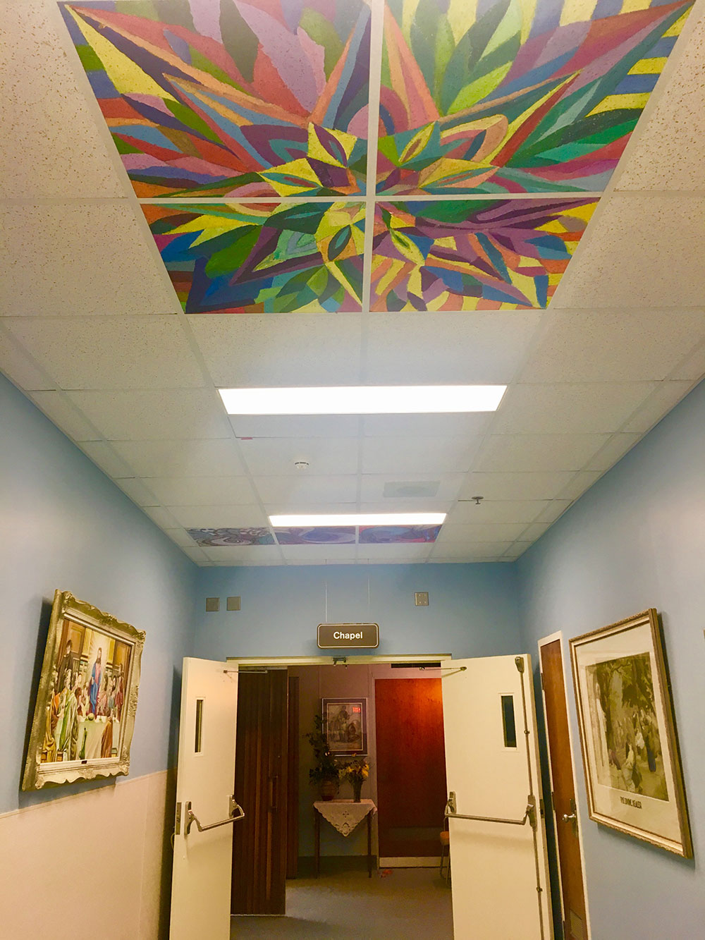 Painted ceiling tiles installed at St Pauls Hospital