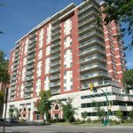 Well-maintained condo building with nearby parks and river