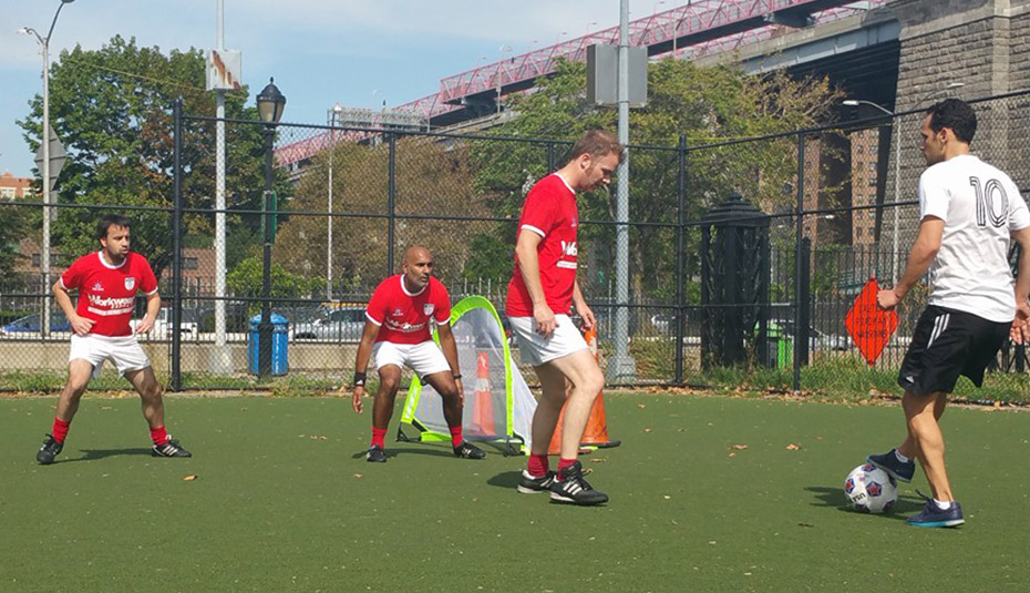 Gourlay, Sangha and Dixon in action on a soccer field in Lower East Side Manhatten