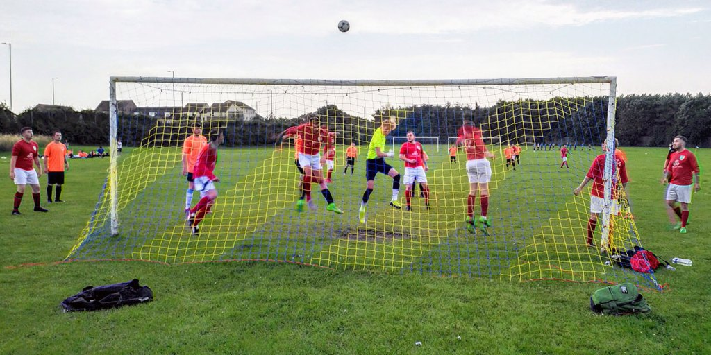 A technicolour goalmouth scramble with an Adidas Tango ball.