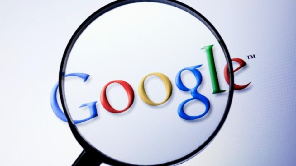 Google logo with a magnifying glass on top of it.