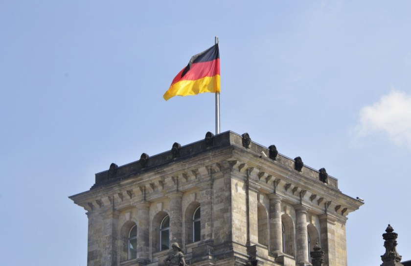 The German flag on top of the Reichstag, Berlin, Germany