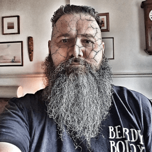 Bearded man with cracked face