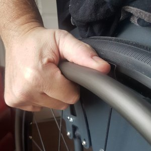 Hand on wheelchair pushrim