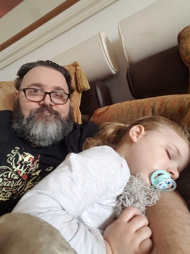 3 year old grand daughter asleep in my arms