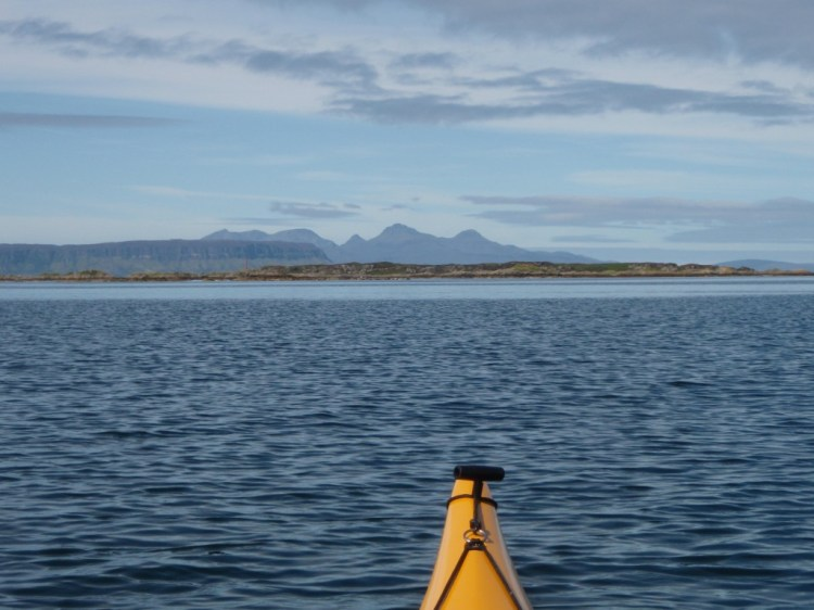 Island of Luinga Mhor with Eigg and Rhum in the distance