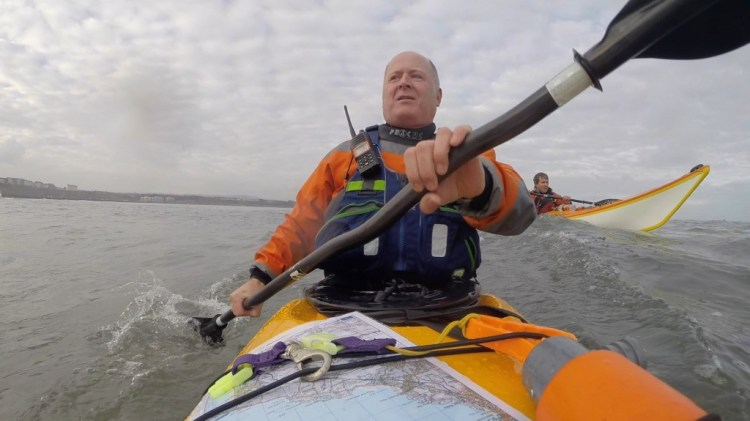 Paddling around the Castle with Clive in the Swell