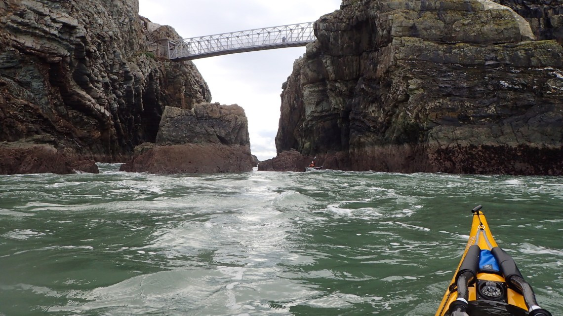 Ashleigh passing under the Bridge of Death with the bridge keeper looking on