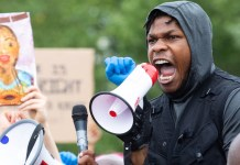 John Boyega has Disney's support after rallying angry protesters in the UK