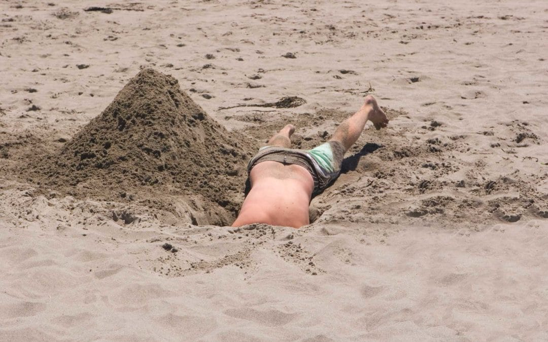 guy stuck in sand