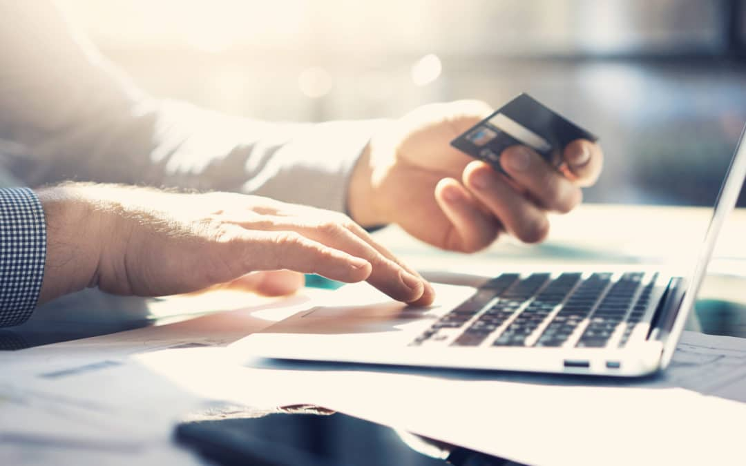 men making online purchase
