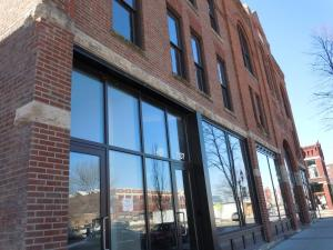The historic CSPS Hall, shown in the New Bohemia district of Cedar Rapids, used historic tax credits in its restoration after the Floods of 2008. A bill in the Iowa Legislature would increase the annual amount of available historic tax credits, among other changes. (photo/Cindy Hadish)