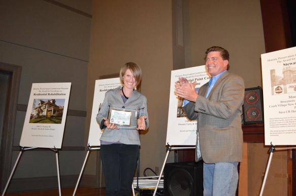Bob Grafton of the Cedar Rapids Historic Preservation Commission applauds after Maura Pilcher, vice president of Save CR Heritage, receives the Stewardship award at the Preservation Showcase on Saturday, May 4, 2013. (photo/Cindy Hadish)