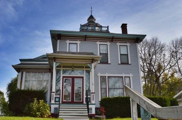 One of two homes built elsewhere and moved into the district, the Spencer house was built in 1873 and moved to 1955 B Ave. NE in 1912. (photo/Cindy Hadish)