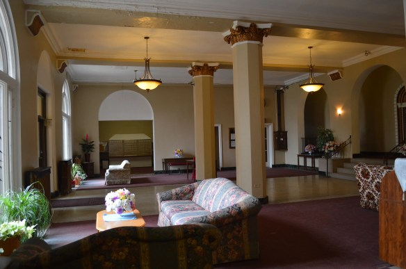 The hotel-style lobby inside the Commonwealth Apartments reflects the origins of the building as an extended-stay hotel. (photo/Cindy Hadish)