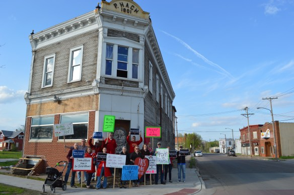 "Members of Save CR Heritage and other supporters are shown on Friday, May 9, 2014, in one of the last photos of the Hach Building with the ""P. Hach"" nameplate intact. The signature piece was removed the following morning. (photo/Cindy Hadish)"