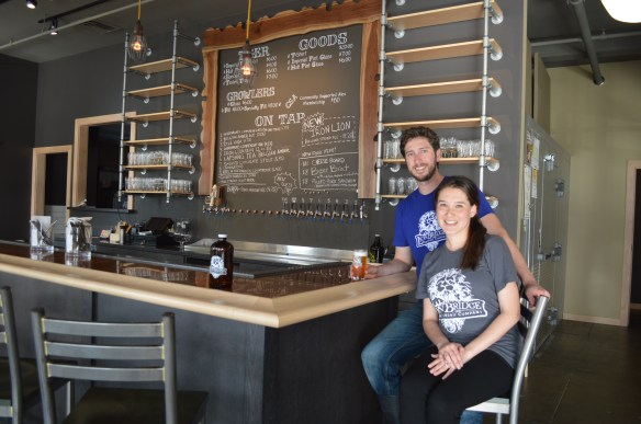 Quinton McClain and his fiancee, Ana Escalante, are shown inside Lion Bridge Brewing Company this month in Cedar Rapids. (photo/Cindy Hadish)